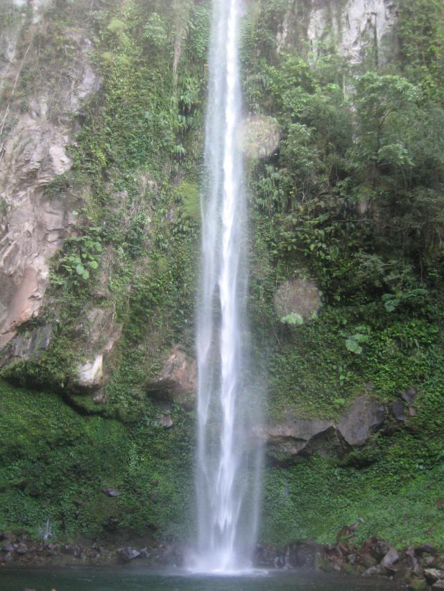 Katibawasan Falls is a stunning, clear waterfall, plunging 75 meters into a rock pool surrounded by ground orchids, wild ferns, trees and boulders.Its cold water provides a refreshing summer splash to bathers and picnickers. Description Source: http://www.camiguintourismassociation.com/camiguin/Katibawasan.html Photo taken by Nadine Marie V. Niguidula, MA 2013 © Aligning With Truth