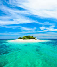 Small Tropical Island with Blue Sky and Ocean by Alberto Pomares Vetta © Getty Images