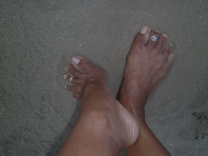Nail polish and pedi, I can do without. But toe rings are certainly a must!